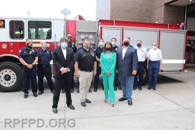 Pictured in front with Congresswoman Newman:  L-R:  Board Secretary Steve Stratakos, Fire Chief Jeff Ketchen, Congresswoman Marie Newman, Board President Brian A. Bernardoni.