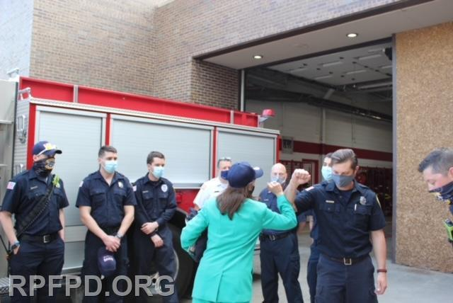 Congresswoman Newman greets the on-duty members of the Roberts Park Fire Protection District.
