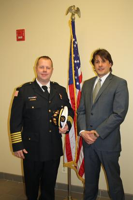 Fire Chief Ketchen (left), with Trustee Steve Stratakos
