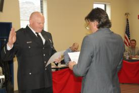 Christopher Grazier is sworn in as Lieutenant by Trustee Steve Stratakos at the May 12, 2015 Board of Trustees' meeting.  Grazier has been a member of Roberts Park Fire Protection District since June, 2008. (For more photos, click on the Photo Galleries tab.)
