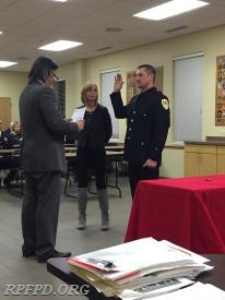 Trustee Steve Stratakos issues the oath for FF/PM Anthony Palkovitz.