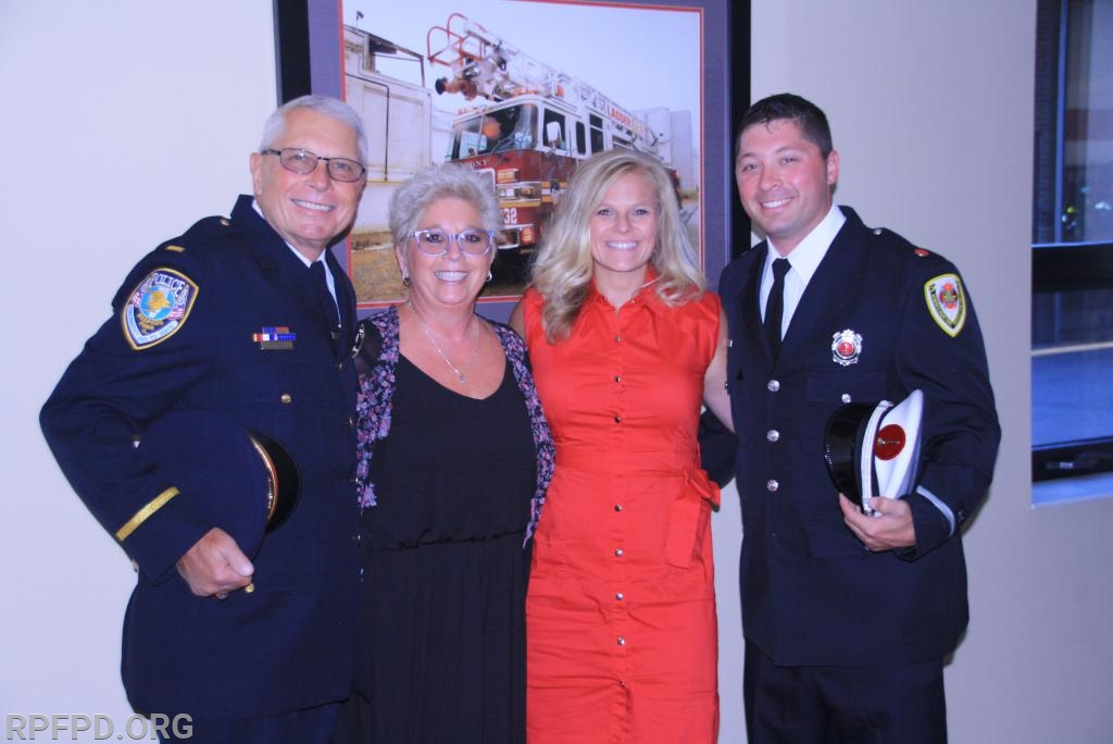 Lt. Janchenko is joined by his parents and wife during the promotion ceremony.   Pictured L-R:   Jim Janchenko, Marcia Janchenko, Maripat Janchenko.