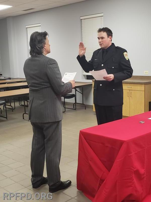 James Evans is sworn in as Firefighter/Paramedic by Trustee Steve Stratakos at the December 10, 2019 board meeting.