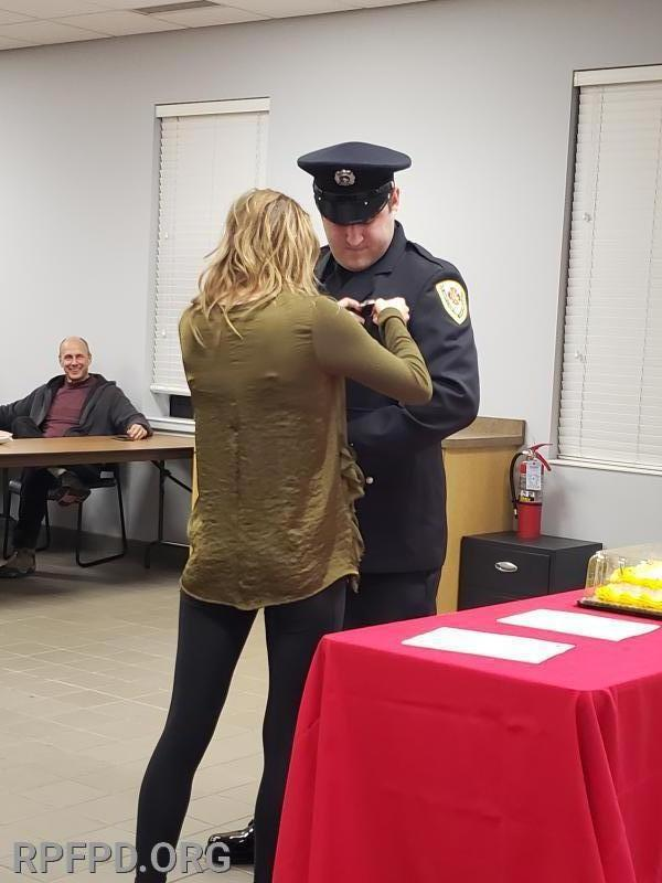 FF/PM Steve LaRocco's sister, Leigh, pins his badge on during the swearing-In ceremony. 1/14/2020